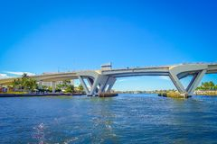FORT LAUDERDALE, USA - JULY 11, 2017: Nice view of an opened bridge raised to let ship pass through at harbor in Fort. Lauderdale, Florida Stock Image