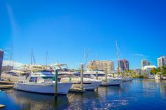 FORT LAUDERDALE, USA - JULY 11, 2017: Some yatchs parket in a raw in a riverwalk promenade, with condominium buildings. Behind, in Fort Lauderdale, Florida stock images