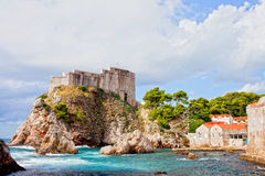 Fort Lovrijenac in Dubrovnik. Picturesque scenery of a small bay on the Adriatic Sea and fort Lovrijenac medieval landmark in Dubrovnik, Croatia, Dalmatia County Royalty Free Stock Images