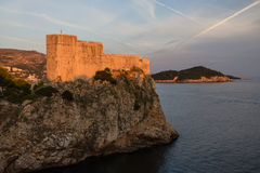 Fort Lovrijenac in Dubrovnik at sunset. View of Fort Lovrijenac (St. Lawrence Fortress) on top of a steep cliff in Dubrovnik, Croatia, at sunset Stock Photo