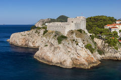 Fort Lovrijenac in Dubrovnik. View of Fort Lovrijenac (St. Lawrence Fortress) on a steep cliff in Dubrovnik, Croatia Royalty Free Stock Photos