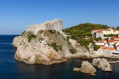 Fort Lovrijenac and other buildings in Dubrovnik. View of Fort Lovrijenac (St. Lawrence Fortress) on a steep cliff and other buildings in Dubrovnik, Croatia Stock Images