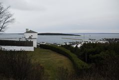 Fort Mackinac, from behind. The Fort Mackinac stronghold as seen from behind with downtown Mackinac Island, the straits of Mackinac and round island in the royalty free stock photos