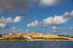Fort Manoel on an island in the Marsamxett Harbour, Malta. Fort Manoel stands majestically on a small island in the harbour between Valetta and Sliema on Malta`s Stock Image