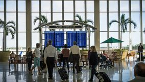 Fort Meyers - Florida - December 17, 2017- Passengers check out flight informations at Southwest International airport during holi Stock Image