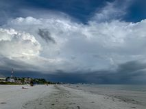 Cumulonimbus clouds moving in at Fort Myers Beach on Estero Island, Florida. Fort Myers Beach, FL / USA - 11/3/18: Cumulonimbus clouds moving in at Fort Myers stock photo