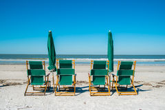 Fort Myers Beach. Lounge chairs along popular Fort Myers Beach on the west coast of Florida Royalty Free Stock Image