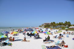 Fort Myers Beach. March 14, 2015:FLORIDA - Colorful Atlantic coast beach scene of many people suntanning, relaxing and enjoying the shore and beach during Stock Images