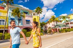 Free Fort Myers Beach Traditional Colorful Cottages Houses - Couple On Winter Vacation In Sun Walking Holding Hands Near Fort Royalty Free Stock Photography - 194213947