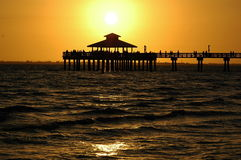 Fort Myers Sunset. Sun setting behind pier at Fort Myers Fla Stock Photography