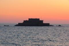 Fort National is during high tide at sunset, Saint-Malo, Brittany, France Stock Photography