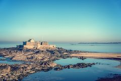 Fort National at low tide in Saint Malo, Brittany France. Fort National at low tide in Saint Malo, Brittany, France royalty free stock photos