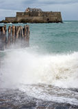 Fort National and Stormy Seas. The Fort National in Saint-Malo, France during stormy seas royalty free stock photography