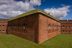 Fort Nelson Victorian Fort. White clouds in blue sky over red brickwork of Victorian fort Nelson near Portsmouth, Hampshire, UK, which houses the Royal Armouries Stock Photos
