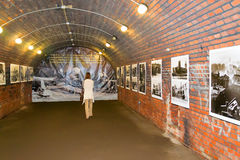 Fort No. 5. KALININGRAD, RUSSIA - JUNE 27, 2015: A woman visits the exhibition of rare military photos the Storming of Kenigsberg  in the Fort №5 of Stock Photos