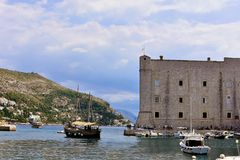 Fort and old sailboat in Dubrovnik. The St. John Fortress Croatian: Sveti Ivan, often called Mulo Tower, is a complex monumental building on the southeastern Stock Image