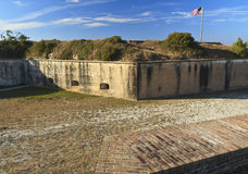 Fort Pickens Dry Moat. Sand filled dry moat between the walls of civil war era Fort Pickens in the Gulf Islands National Seashore near Pensacola, Florida Royalty Free Stock Image