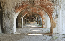 Fort Pickens exterior arches. Weathered brick arches in a bastion of civil war era Fort Pickens in the Gulf Islands National Seashore near Pensacola, Florida Royalty Free Stock Photo