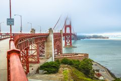Fort Point Golden Gate Bridge. Fort Point view of Golden Gate Bridge south shore, symbol landmark of San Francisco, California, United States. Typical fog in royalty free stock image