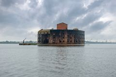 Fort In the Rain. The facade of the Fort `Emperor Alexander I` the Plague closeup. Gulf of Finland, Kronstadt Stock Image
