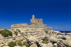 Fort of Rhodes at the entrance to the bay of Port sunny day Royalty Free Stock Photo