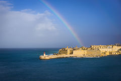 Fort Ricasoli after the storm, Malta. Fort Ricasoli and Breakwater with the lighthouse, Grand Harbour, Malta Royalty Free Stock Photo