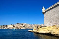 Fort Saint Angelo and Valletta. Corner tower on Fort Saint Angelo with views towards Valletta, Vittoriosa Birgu, Malta, Europe Stock Images