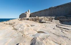 Fort Saint Elmo Valetta, Malta. And stony shore stock images