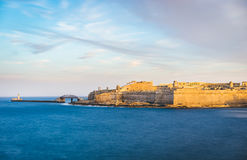 Fort Saint Elmo, Valletta, Malta. Fort Saint Elmo and Breakwater with the lighthouse at sunset, Valletta, Malta Royalty Free Stock Photography