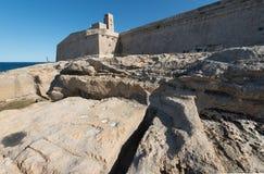 Fort Saint Elmo in Valletta Malta. Rocky coast and Fort Saint Elmo in Valletta Malta Stock Photo