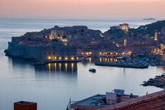 Fort of saint John and old town at night. Dubrovnik. Croatia. Fort of saint John, the old port, the old town and Fort Lovrijenac  at a distance at night Royalty Free Stock Image