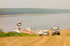 The fort simpson ferry in the northwest territories. A vessel used for transporting vehicles and passengers across the mackenzie river Royalty Free Stock Image