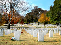Fort Smith National Cemetery, November 2016. National Cemetery in Fort Smith, Arkansas white tombstones lined up on a beautiful green lawn with autumn colors Royalty Free Stock Images