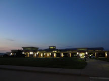 Fort Smith Regional Airport exterior, angle view from entry. Entry and walkway of modern building at the Fort Smith Airport, Fort Smith, Arkansas. Dawn or dusk Royalty Free Stock Image