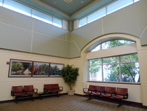 Fort Smith Regional Airport waiting area. Modern waiting area or room with large windows, sky lights and seating at the Fort Smith Airport, Fort Smith, Arkansas Stock Photo