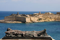 Fort St. Angelo. Fort St. Angel in Valletta, in front a sculpture of Siege Bell Memorial Royalty Free Stock Photo