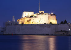 Fort st angelo. An ancient fortification in malta  taken at dusk with top part illuminated Royalty Free Stock Photo