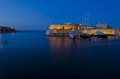 Fort St. Angelo in the evening - Malta. Evening lights on the Grand Harbour and Fort St. Angelo in Malta Stock Photo