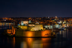 Fort St. Angelo by night. View from Valletta to Vittoriosa and the Fort St. Angelo at night offering a fantastic view over the illuminated builidngs Stock Image