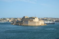Fort St. Angelo over the Harbor. View from Valletta across the Grand Harbor to Fort St. Angelo in Birgu, Malta Stock Photo