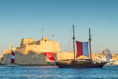 Fort St. Angelo and Sail ship, Grand Harbour, Birgu, Malta, Euro royalty free stock image
