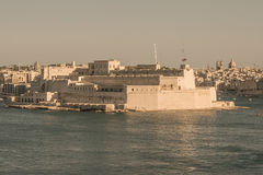 Fort St. Angelo. Fort Saint Angelo is a large bastioned fort in Birgu, Malta, located at the centre of the Grand Harbour. It was originally built in the medieval Royalty Free Stock Photos