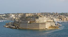 Fort St Angelo in Vittoriosa, Malta. Vittoriosa, Malta - September 29, 2013. Fort St Angelo in Vittoriosa, with Grand Harbor, Vittoriosa city view, yachts and Stock Photo