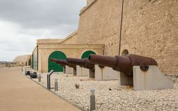 Intramural: Detail view on huge cannon of Fort St. Elmo. Valletta, Malta, Europe royalty free stock photography