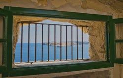 Fort St Elmo`s Window. The View from a window inside Fort St Elmo War Museum in La Valletta,Malta stock image