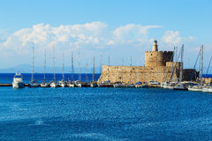 Fort of St. Nicholas and Lighthouse in Mandaki Harbor, Rhodes, Greece Stock Photos