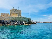 Agios Nikolaos fortress on the Mandraki harbour of Rhodes, Greece. Fort of St. Nicholas in Mandaki Harbor, Rhodes, Greece stock images