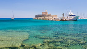 Fort of St. Nicholas and Mandraki port in Rhodes town Stock Image