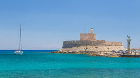 Fort of St. Nicholas and Mandraki port in Rhodes town stock photography