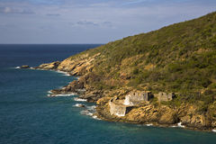 Fort at St. Thomas. A an old stone fort at the base of a hill in St. Thomas, USVI Royalty Free Stock Images